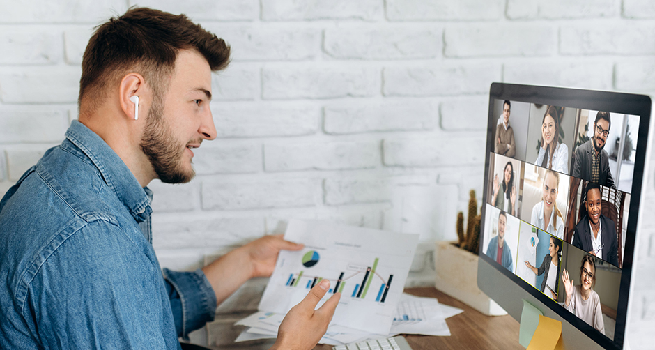 Online business meeting. A young business man communicates by video conference with his business team about a work strategy and plan.